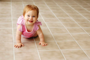 baby on tile picture